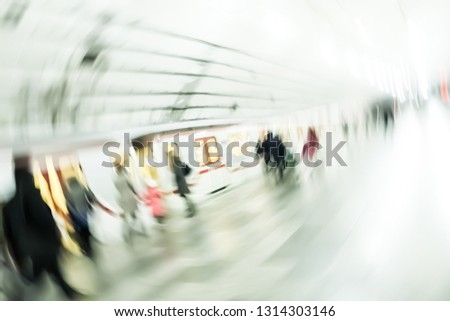 Silhouettes of passengers in the subway. People on a platform. Blurred image of people in a subway. #1314303146