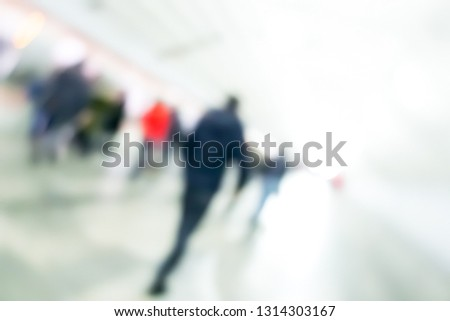 Silhouettes of passengers in the subway. People on a platform. Blurred image of people in a subway. #1314303167