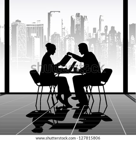 silhouettes of people at a table