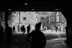 Silhouettes of people going out of the subway in London