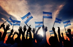 Silhouettes of People Holding Flag of Argentina