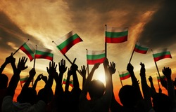 Silhouettes of People Holding Flag of Bulgaria