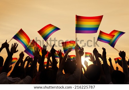 Silhouettes of People Holding Gay Pride Symbol FLag Сток-фото ©
