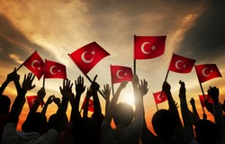 Silhouettes of People Holding the Flag of Turkey