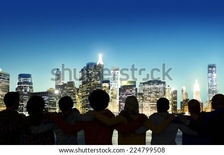 Silhouettes of people\'s back with a view of urban scene.