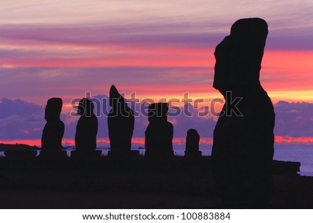 Silhouettes of Tahai Ceremonial Complex, an archaeological site on Rapa Nui (Easter Island, Isla de Pasqua) in Chilean Polynesia after sunset.