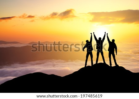 Silhouettes of team on mountain peak. Sport and active life concept #197485619
