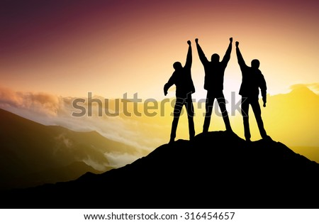 Silhouettes of team on mountain peak. Sport and active life concept #316454657