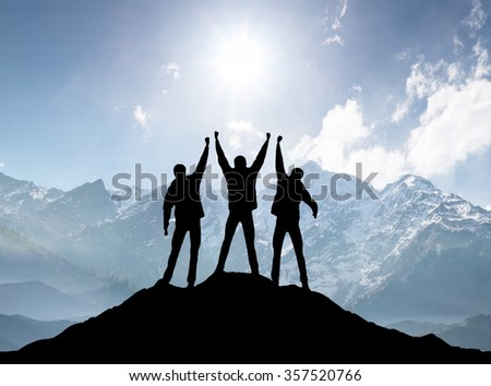 Silhouettes of team on mountain peak. Sport and active life concept #357520766