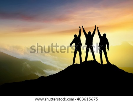 Silhouettes of team on mountain peak. Sport and active life concept #403615675