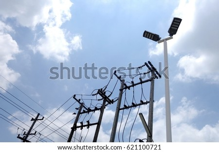 Silhouettes of the power lines and wires and electricity light pole. #621100721