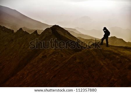 Silhouettes of tourists hiking on Bromo mountain