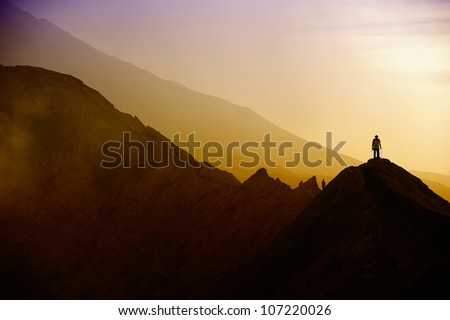Silhouettes of tourists on Bromo mountain