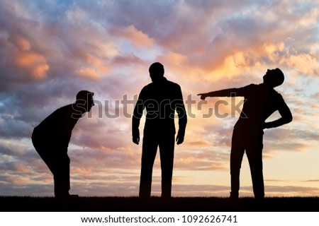 Silhouettes of two men laughing at a sad man pointing a finger at him. The concept of humiliation and insulting people Stock photo ©