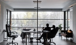 Silhouettes of two men, they are sitting in an office