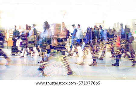 Silhouettes of walking people. Multiple exposure blurred image. Business concept illustration. - Shutterstock ID 571977865