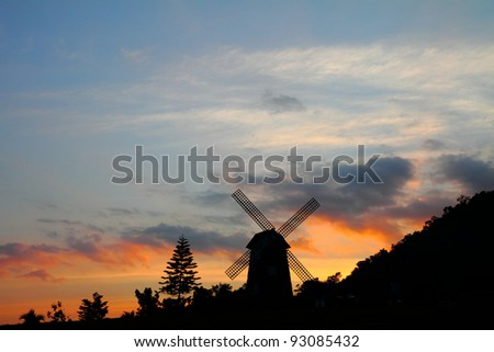 Silhouettes of windmill at sunset, at Thailand - stock photo