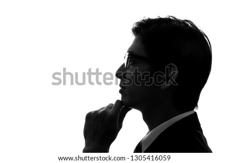 Silhouettes of young businessperson.