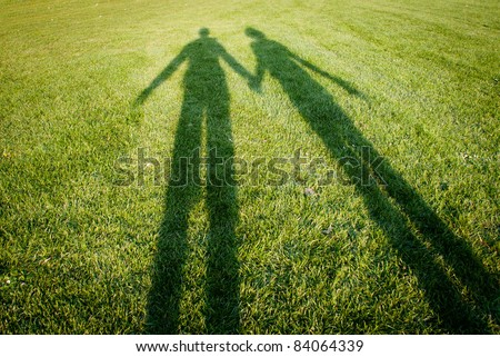 silhouettes over grass