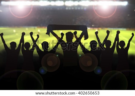 Silhouettes picture of Soccer fans cheering in a match and Spectators at football stadium