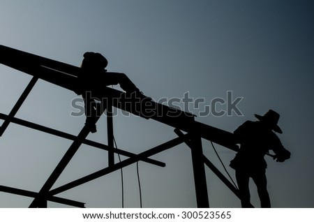 Silhouettes technicians work