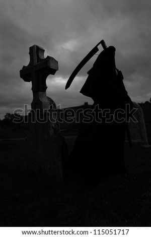Silhoutte of the grim reaper in a graveyard