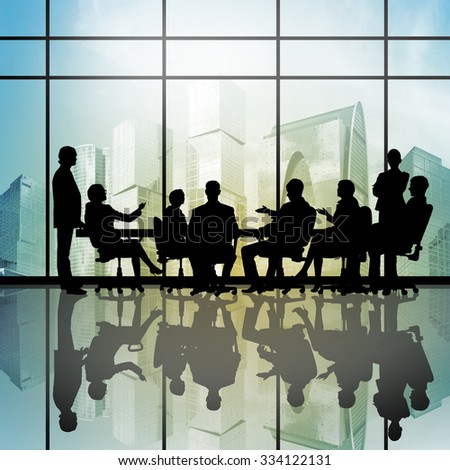 Silhouttes of business people as team sitting round table #334122131
