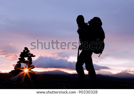 Silhuette of a Hiker with Backpack at Sunrise