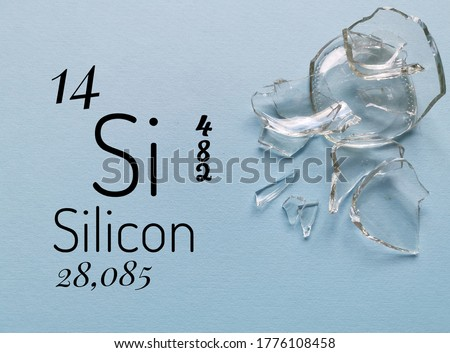 Silicon is a chemical element of the periodic table with the symbol Si and atomic number 14. The symbol Si with atomic data (atomic number, mass and electron configuration) and broken glass pieces.
