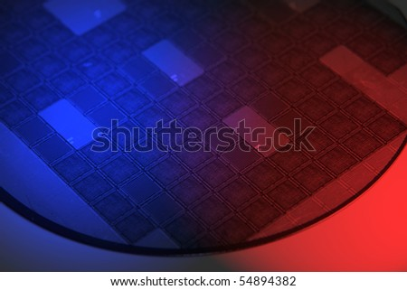 Silicon wafer photographed with red and blue gels