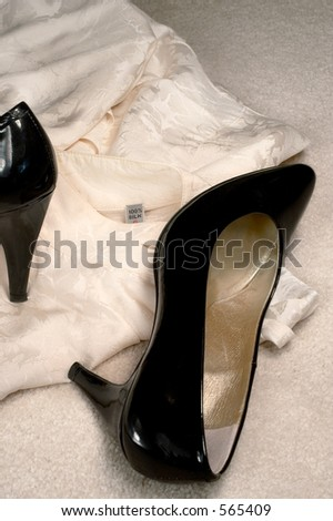 Silk blouse and shoes on the floor