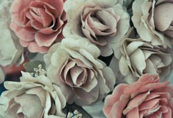Silk dusty pale pink flowers background.
