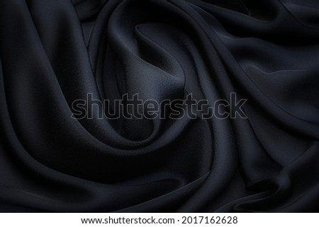 Silk fabric, cadi, black color in the artistic layout Zdjęcia stock ©
