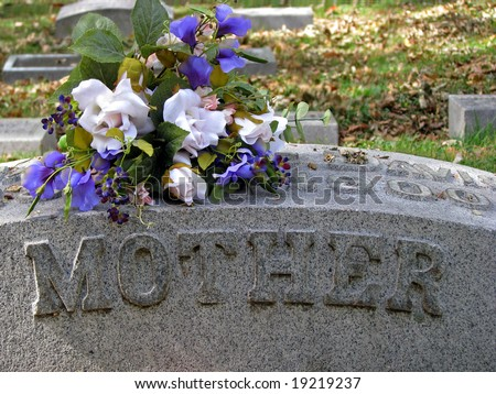 Headstone Floral Arrangements http://www.shutterstock.com/pic-19219237/stock-photo-silk-flowers-on-a-cemetery-grave-headstone-mother.html