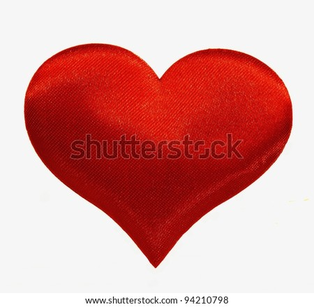 Silk red heart isolated on a white background.