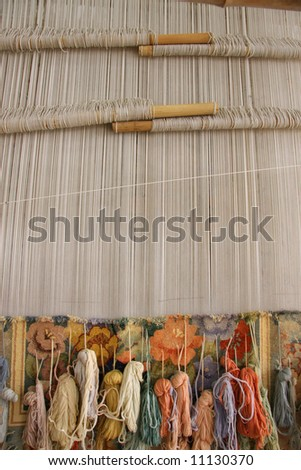 Silk rug weaving on a hand loom in China