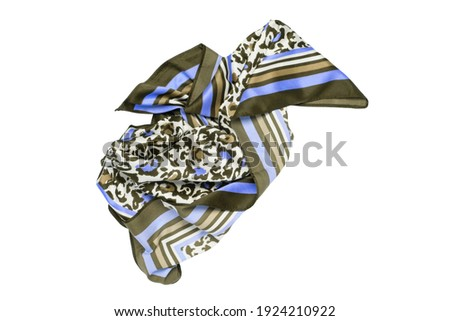 Silk scarf isolated. Closeup of a beautifully folded multicolored blue brown silk scarf or headscarf with a pattern isolated on a white background. Stock fotó ©