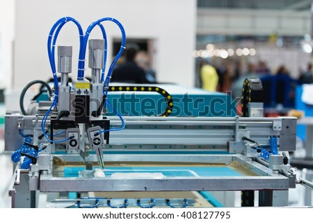 Silk screen printing machine in printing factory