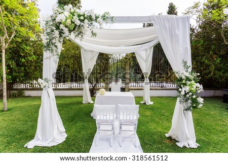 Silk tent for the wedding ceremony for the newlyweds. The garden in the countryside.