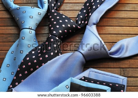 Silk ties on wooden background