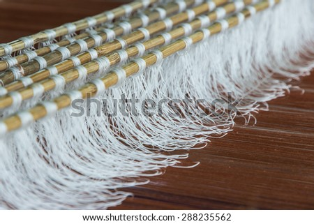 Silk weaving arts and crafts or craft is one that has existed since ancient times. Method of producing a cloth using up yarn and yarn scrub together as a fabric.