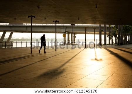sillhoutte of people walking in the morning #612345170