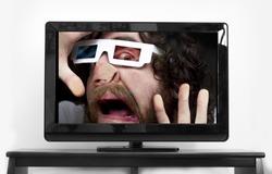 Silly bearded man wearing 3D glasses stuck inside TV screen