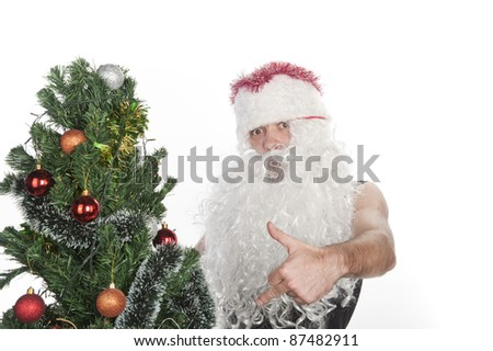 silly crazy santa shows gestures at the Christmas tree, isolated over white, the celebration of Christmas