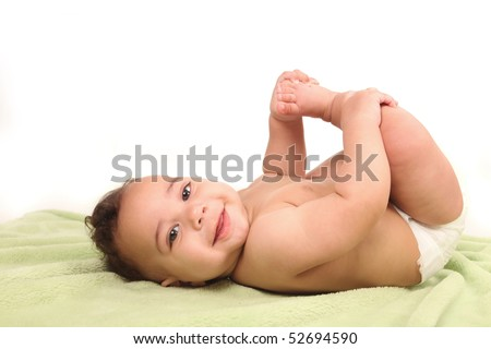 Silly Happy Baby Infant Boy Holding His Foot on White Background