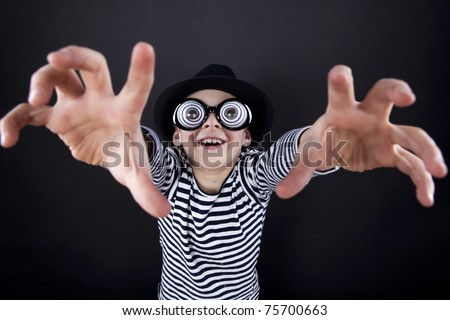 Silly little boy in black hat and striped vest with play eyeball glasses. I'm coming for you