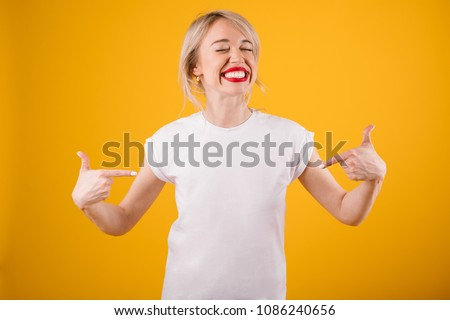 Silly smiling funny woman in white t-shirt where you can place ypur logo text or image.