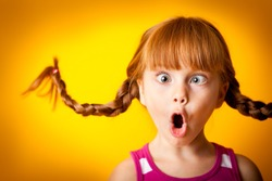 Silly, Surprised Little Girl with Pigtails