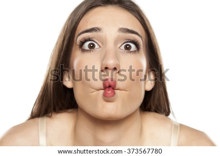 silly young woman making funny faces