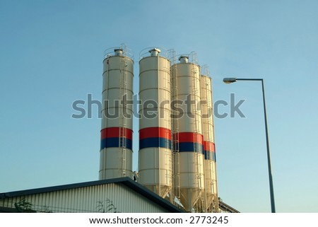 Silo tanks in roof of industrial factory